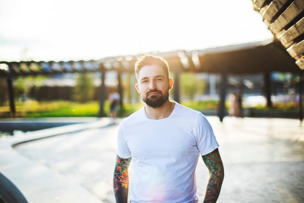 Portrait of tattooed man stock photo