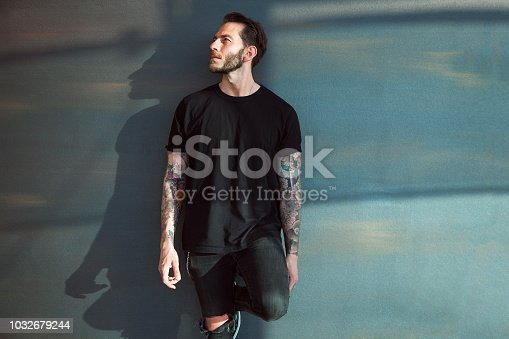 Portrait of tattooed young man