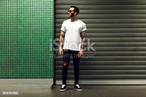 istock Portrait of tattooed young man 959264892