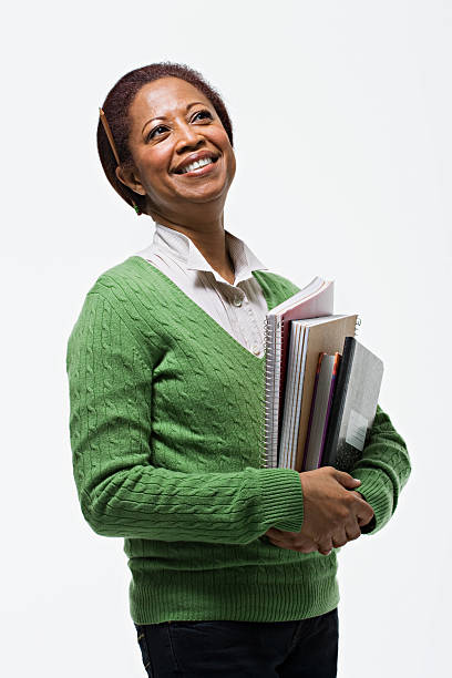 Portrait of teacher holding books stock photo