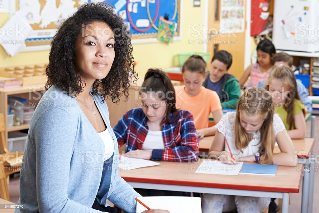 Portrait Of Teacher In Class With Pupils - Photo