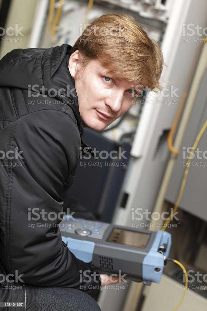 Portrait of technician with reflectometer stock photo