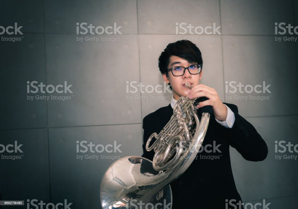 Portrait Of Teen Musician Playing Instrument Classic French