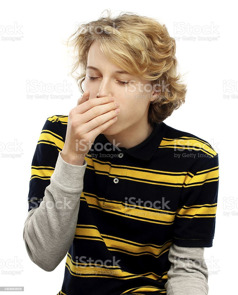 Portrait of teenage boy coughing.White background royalty-free stock photo
