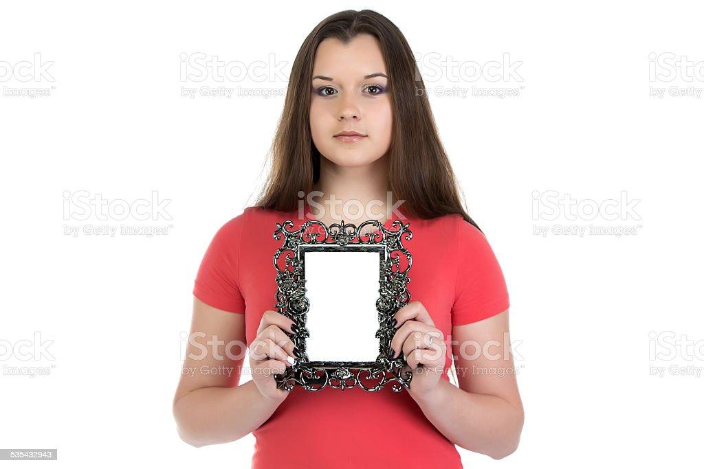 Portrait of teenage girl holding photo frame stock photo