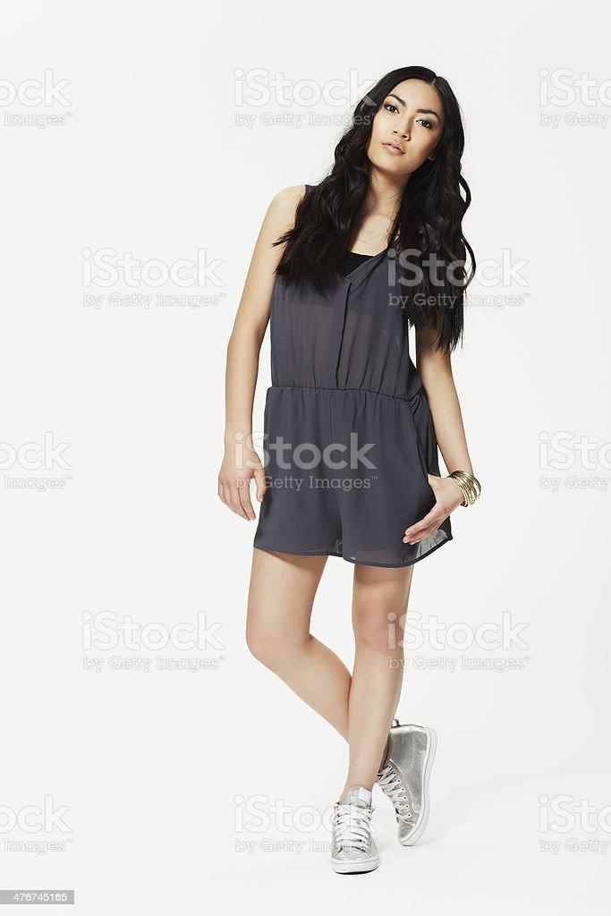 Portrait of teenage girl in grey dress, studio royalty-free stock photo