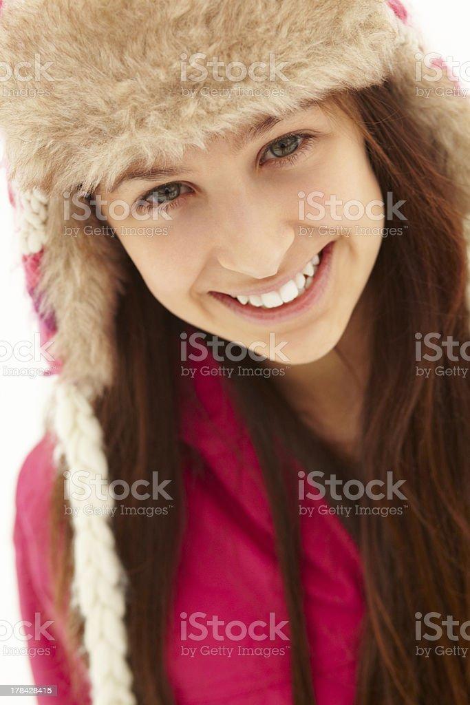 Portrait Of Teenage Girl In Snow Wearing Fur Hat stock photo