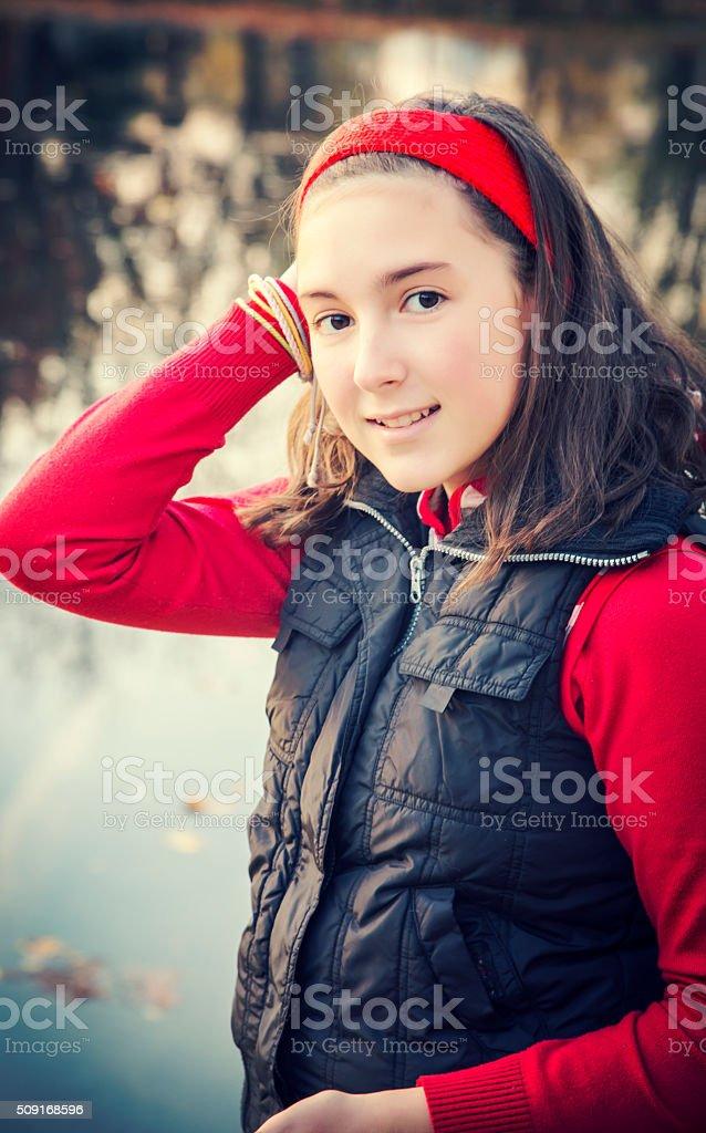 Portrait of teenage girl standing near lake royalty-free stock photo