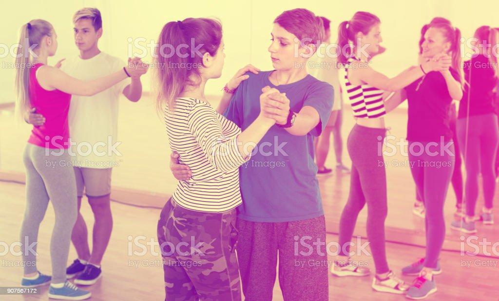 Portrait of teenagers dancing of partner dance stock photo