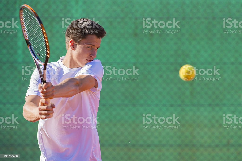 Portrait of Tennis Player at Backhand Drive royalty-free stock photo