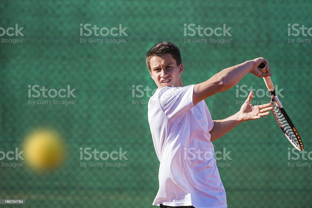 Portrait of Tennis Player at Forehand Drive stock photo