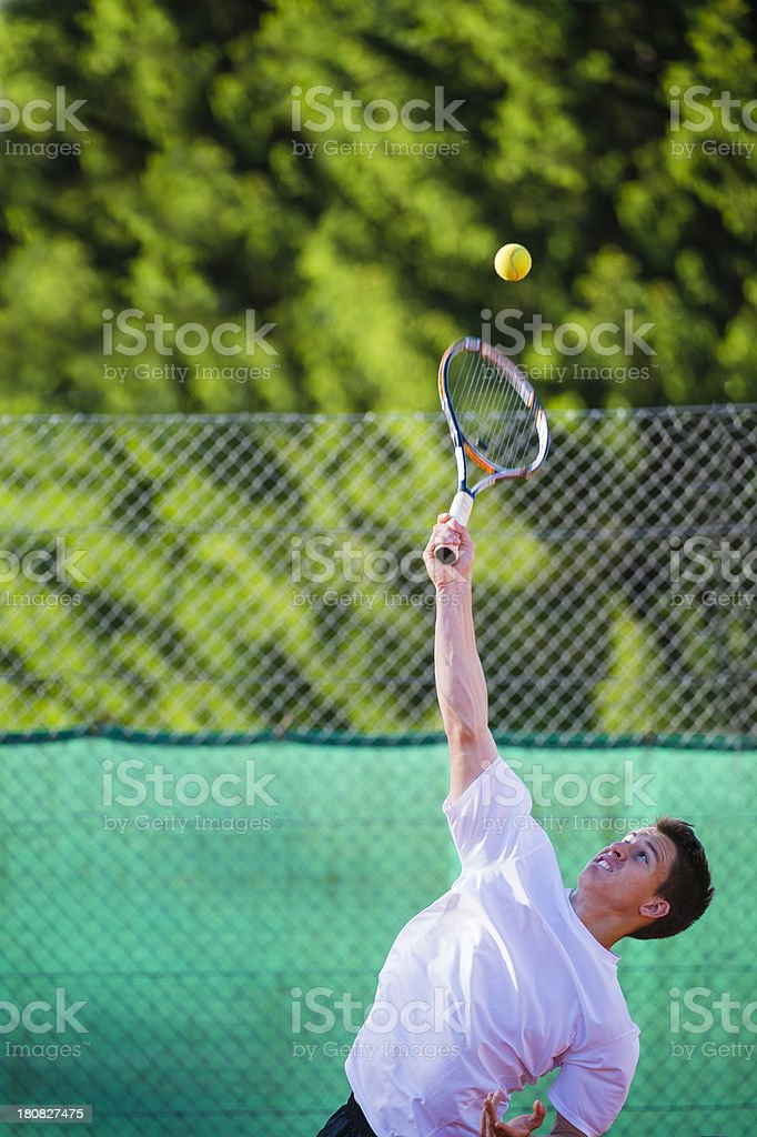 Portrait of Tennis Player at Servis royalty-free stock photo