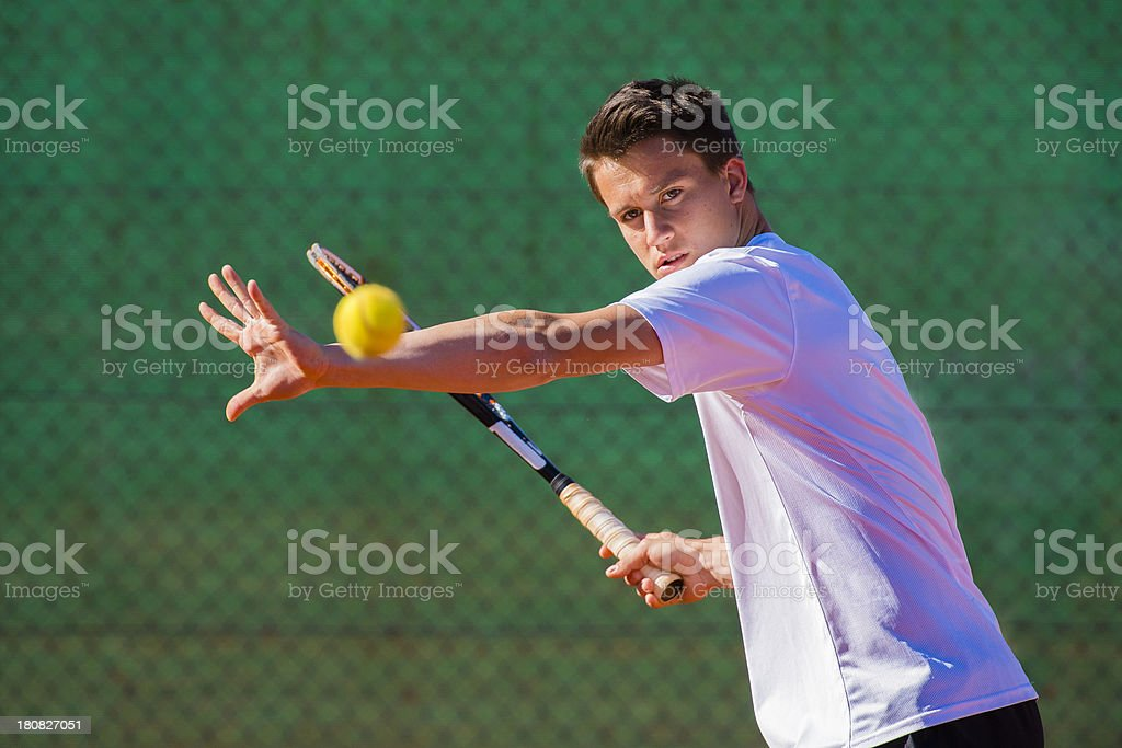 Portrait of Tennis Player Concentrating for Forehand Drive stock photo