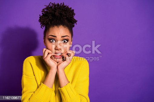 istock Portrait of terrified beautiful youth nails bite hear horrible news wear stylish trendy pullover jumper isolated over purple violet background 1162139577