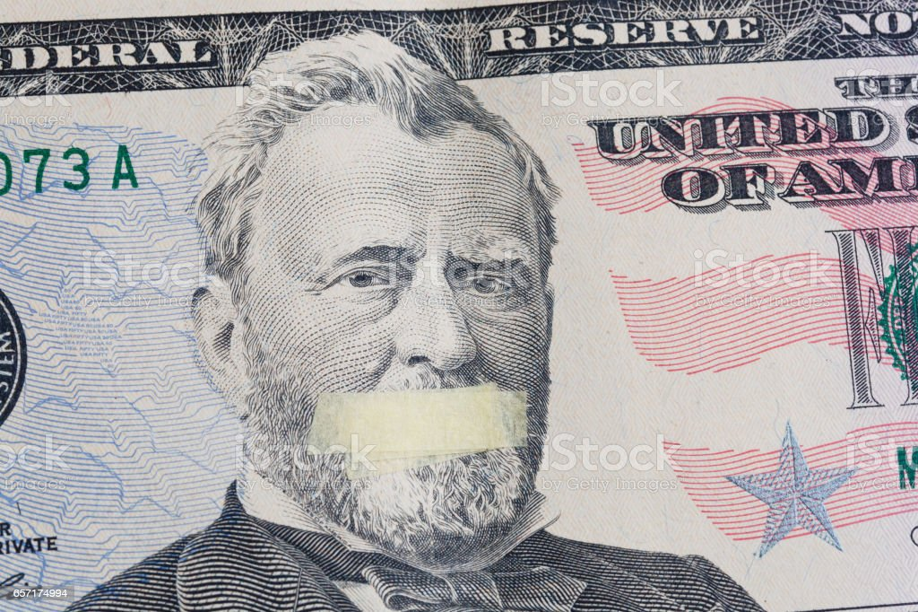 Portrait of the American leader Ulysses Grant with mouth glued on the banknote of fifty dollars USA stock photo