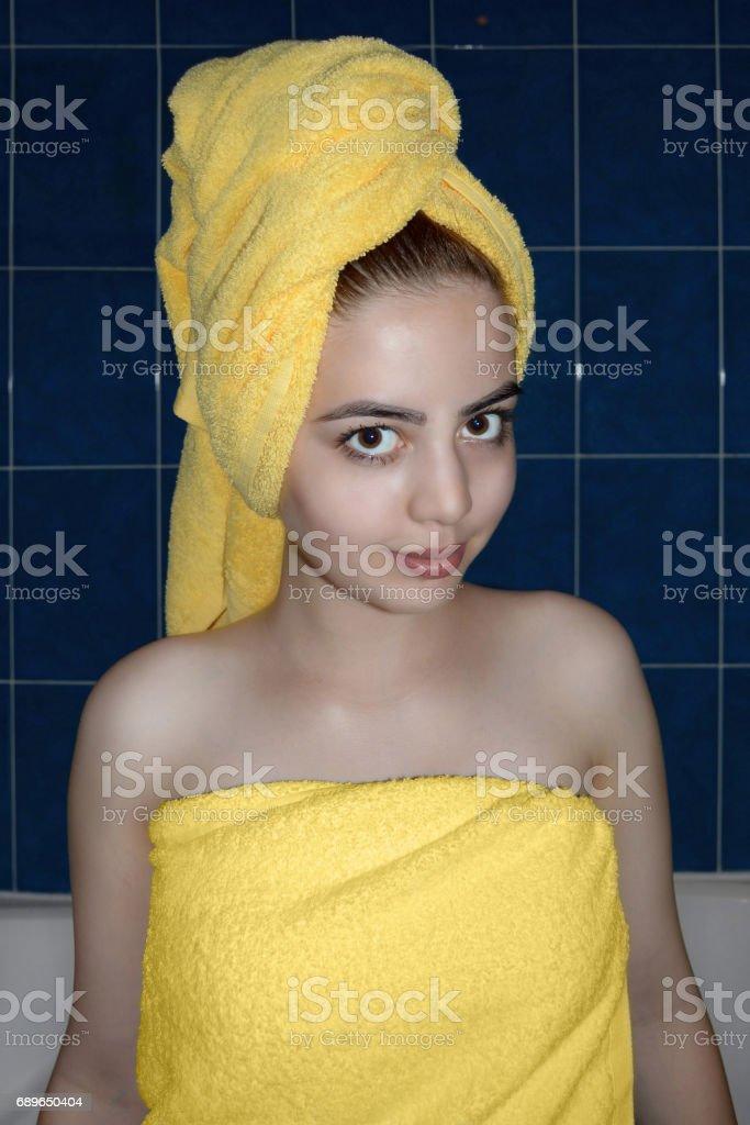 portrait of the beautiful girl in bath towel stock photo
