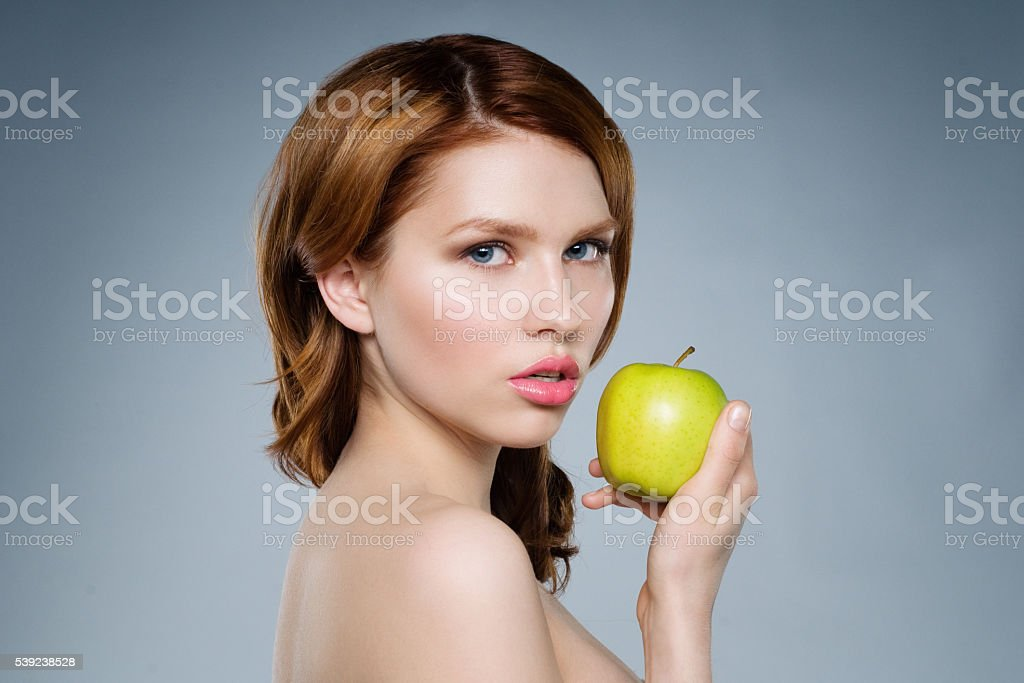 Portrait of the beautiful red-haired girl royalty-free stock photo
