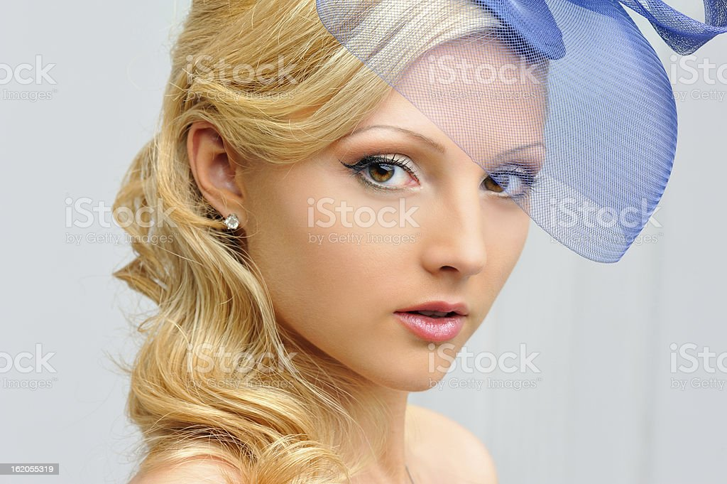 Portrait of the beautiful woman in a hat. royalty-free stock photo