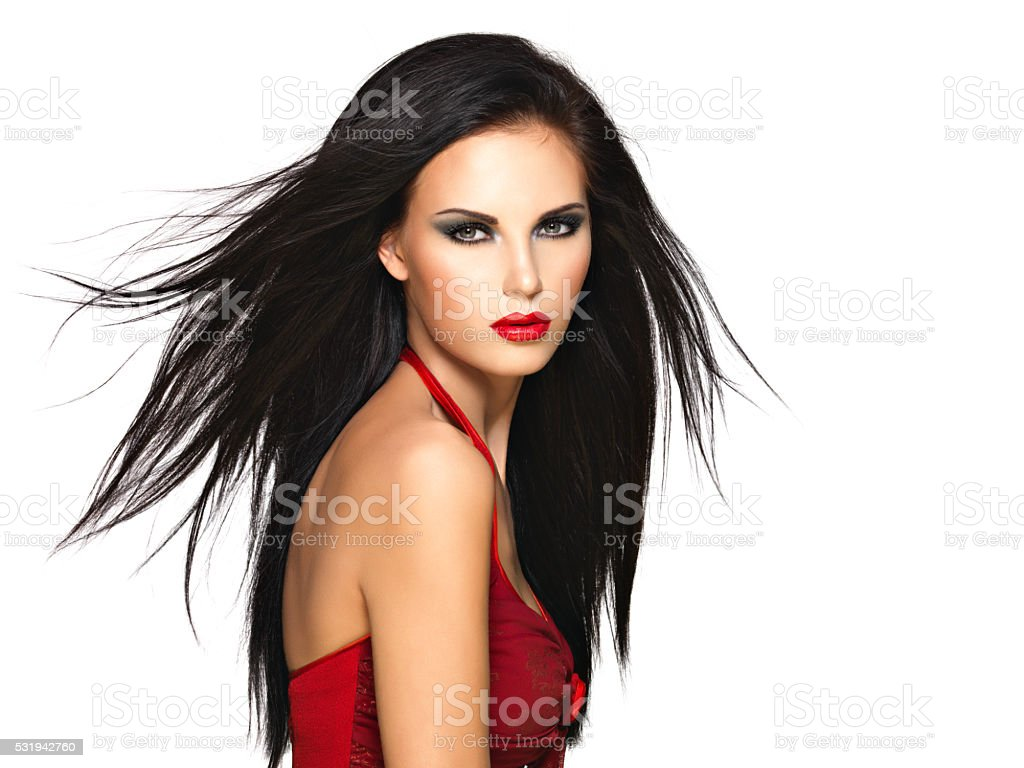 Portrait of  the beautiful woman with  black hairs and red stock photo