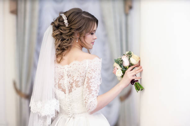 portrait of the bride on the window background - veil stock pictures, royalty-free photos & images