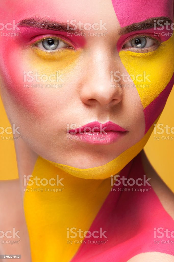 Portrait of the bright beautiful girl with art colorful painting make-up and bodyart royalty-free stock photo