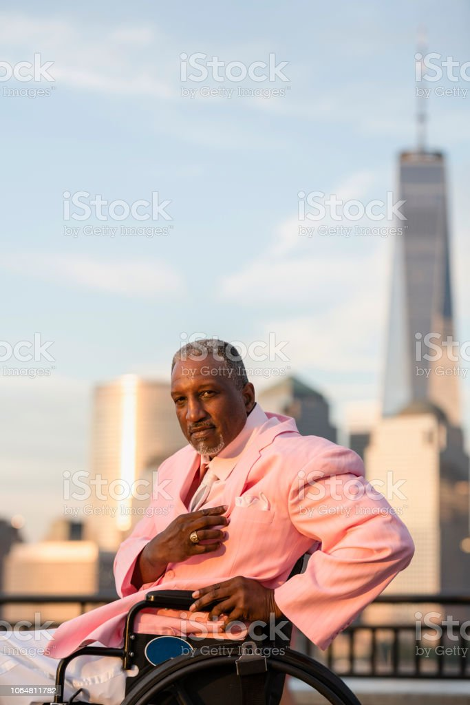 Portrait of the disabled Afro-American Black veteran traveling in America, visiting Liberty State Park in New Jersey. stock photo