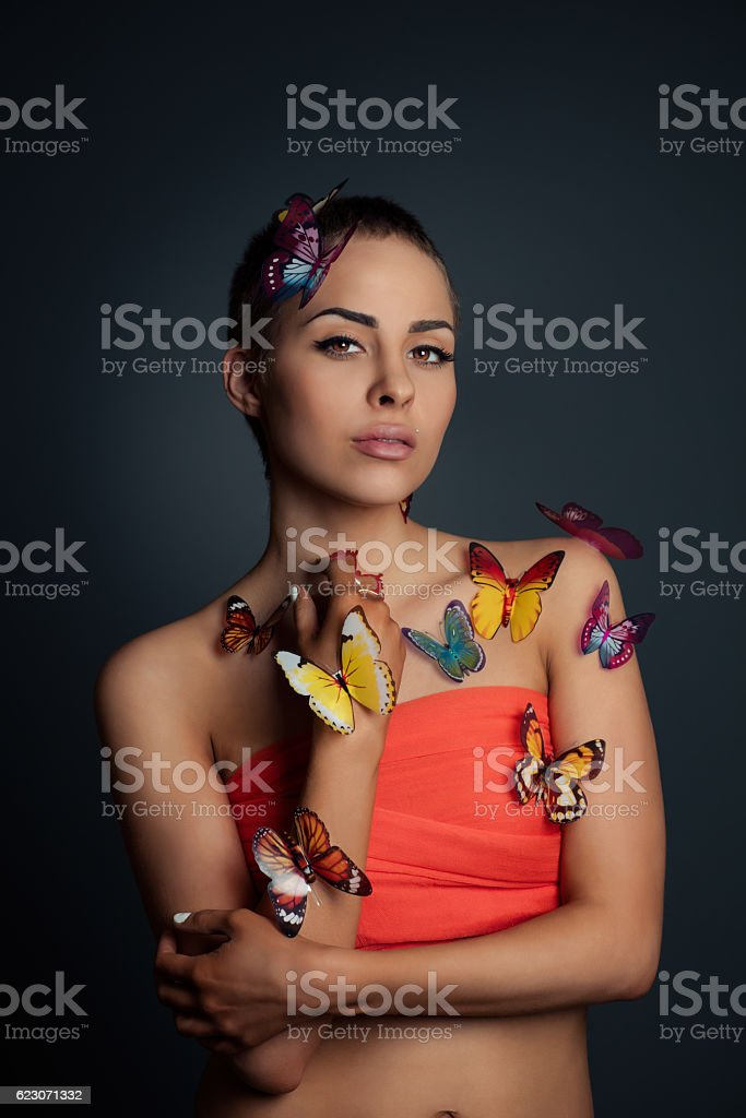 Portrait of the girl and butterflies stock photo