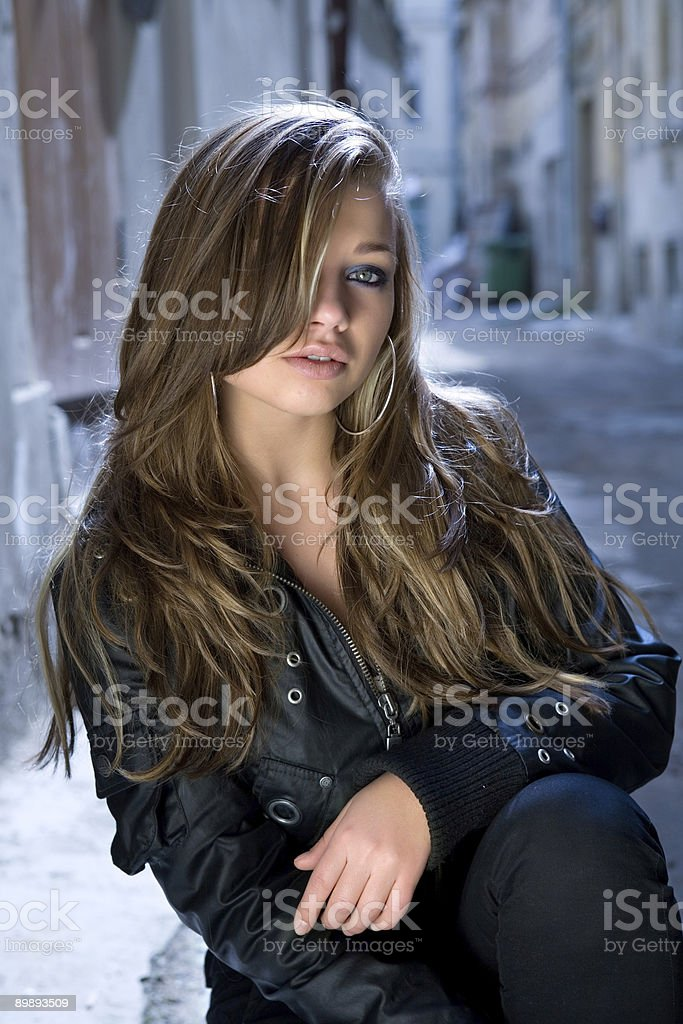 Portrait of the girl in a court yard royalty-free stock photo