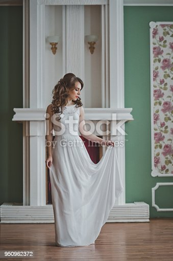 The girl in a wedding white dress.