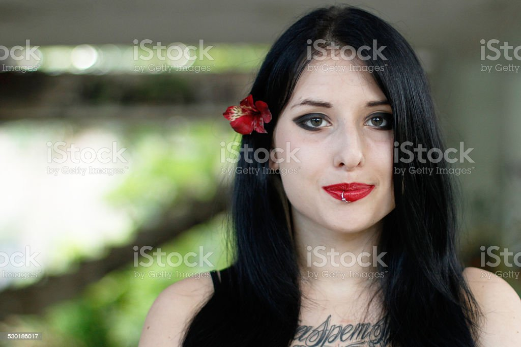 Portrait of the girl with a flower stock photo