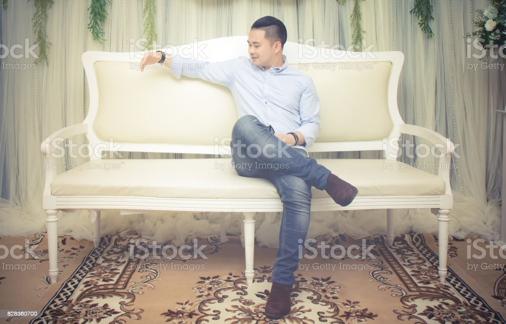 Portrait of the handsome man with living room in wedding day stock photo