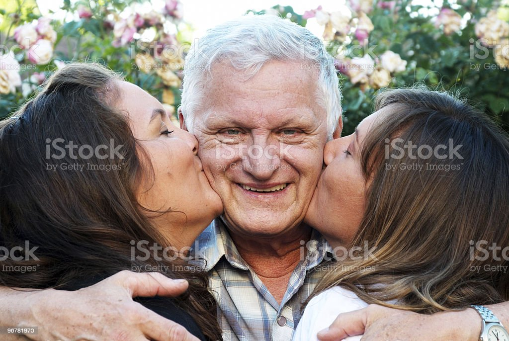 Portrait of the happy elderly father with two daughters royalty-free stock photo