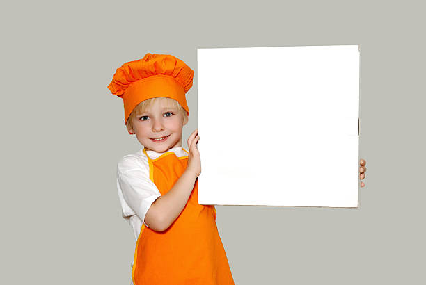Portrait of the little cook with a box for pizza stock photo