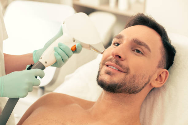 Portrait of the man at laser hair removal procedure stock photo