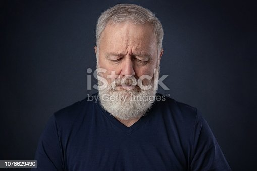 istock Portrait of the old man looking down 1078629490
