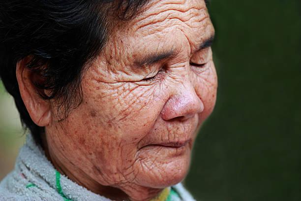 Portrait of the old woman sad stock photo