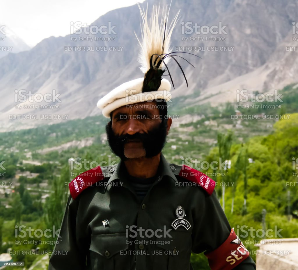 Portrait of the pakistanian guard of the Baltit fortress at Hunza valley, Karimabad, Pakistan royalty-free stock photo