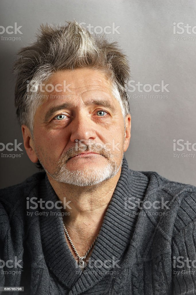 Portrait of the pensive man at the age stock photo