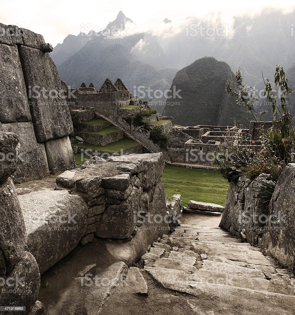 Portrait of the Ruins of Machu Picchu with snowy mountains stock photo