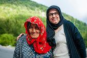 Senior Muslim shepherd with her daughter