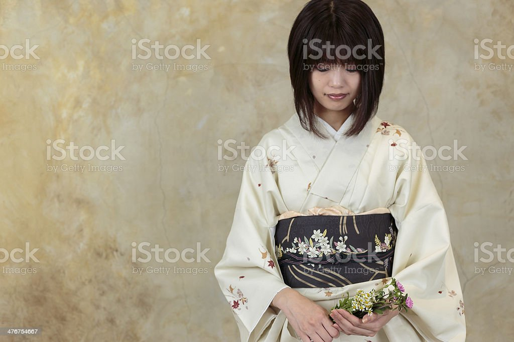 Portrait of the woman in a kimono royalty-free stock photo