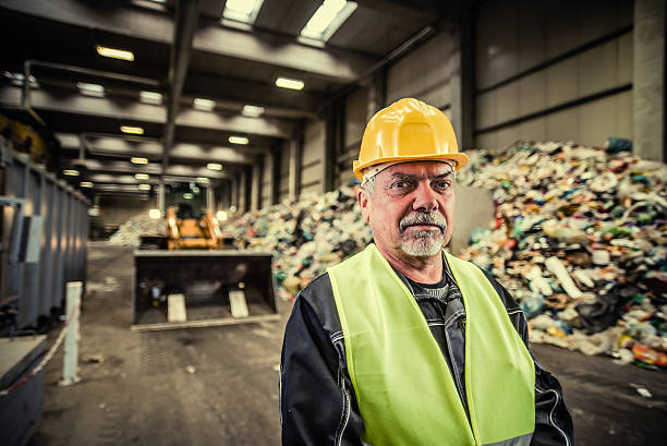 Portrait of the worker at the garbage dump stock photo