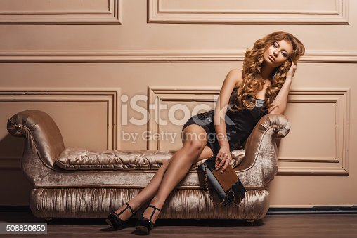 istock Portrait of the young beautiful woman in leather shoes 508820650