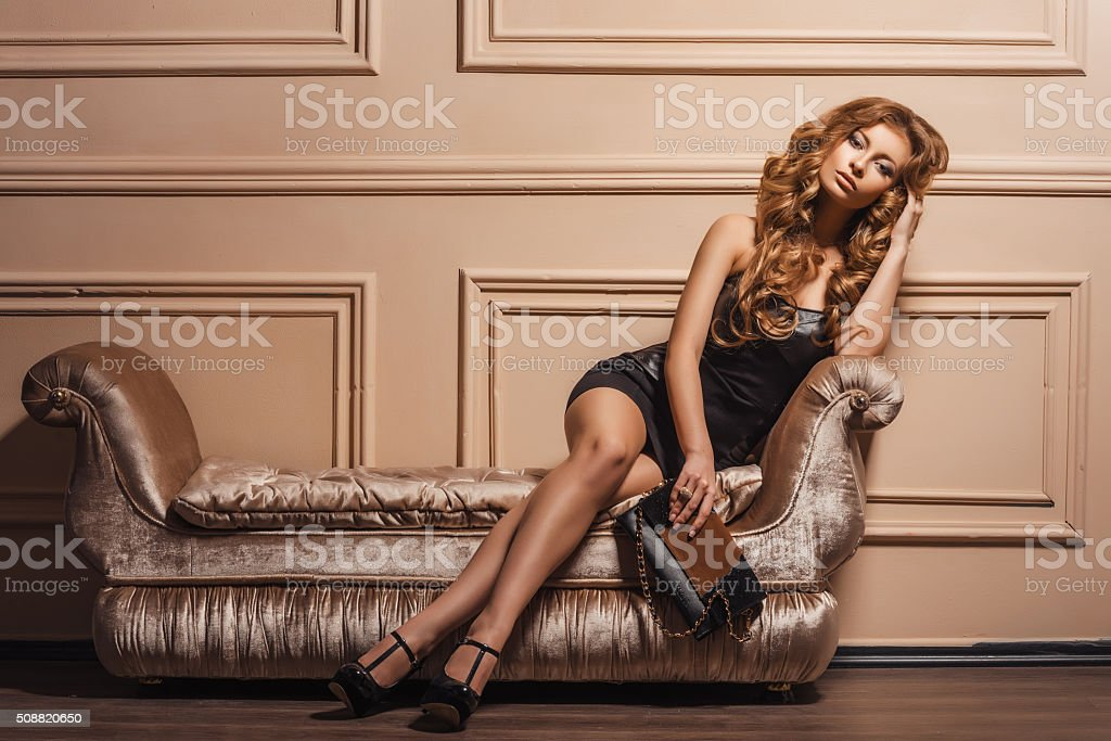 Portrait of the young beautiful woman in leather shoes stock photo