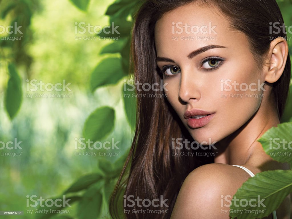 portrait of the young beautiful woman with long hairs. outdoors stock photo