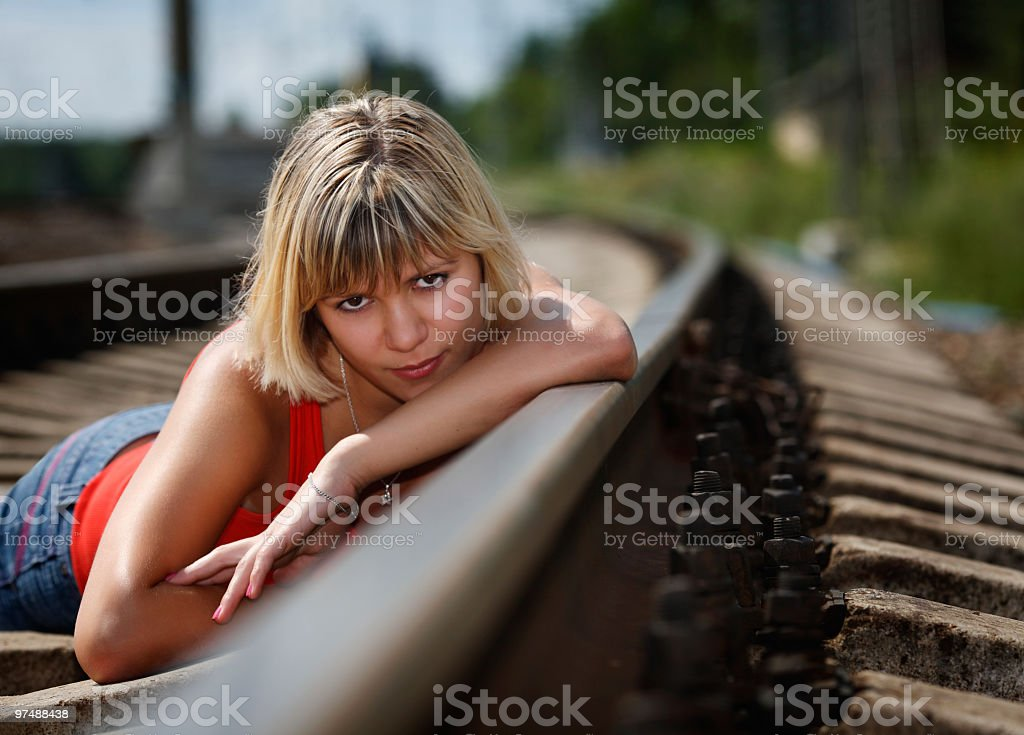 Portrait of the young girl on railway royalty-free stock photo