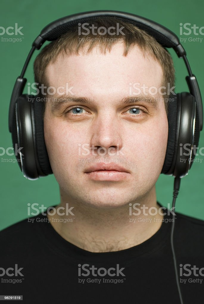 Portrait of the young man in headphones royalty-free stock photo