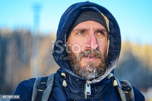 istock Portrait of the young man with  beard in hoarfrost 637991006