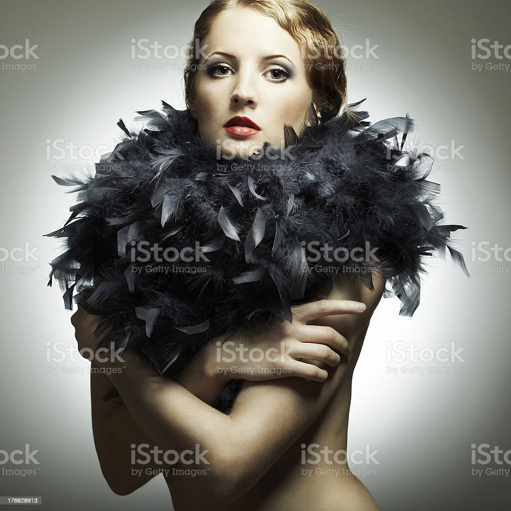 Portrait of the young woman from a boa royalty-free stock photo