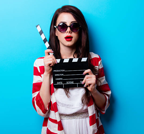 portrait of the young woman with slapstick stock photo
